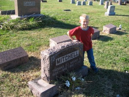 My son Ethan helped to find an elusive tombstone. Photo by Cari A. Taplin