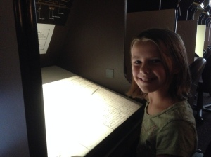Ellie at a microfilm reader in the FHL