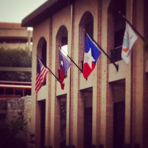 Flags adorn a building in San Antonio.
